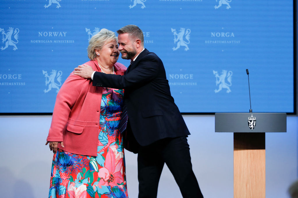 Norway's Prime Minister Erna Solberg is hugged by Norway's Minister of Health Bent Hoie during a press conference on the corona Covid-19 situation in Oslo, on September 24, 2021. - Norway OUT (Photo by Javad Parsa / NTB / AFP) / Norway OUT (Photo by JAVAD PARSA/NTB/AFP via Getty Images)