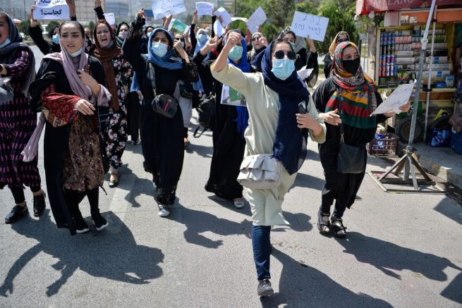 TOPSHOT - Afghan women shout slogans during an anti-Pakistan protest rally, near the Pakistan embassy in Kabul on September 7, 2021. - The Taliban on September 7, 2021 fired shots into the air to disperse crowds who had gathered for an anti-Pakistan rally in the capital, the latest protest since the hardline Islamist movement swept to power last month. (Photo by Hoshang Hashimi / AFP) (Photo by HOSHANG HASHIMI/AFP via Getty Images)