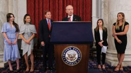 WASHINGTON, DC - SEPTEMBER 15: (L-R) Former U.S. Olympic gymnast McKayla Maroney, national champion Jessica Howard, Olympian Aly Raismam, Sen. Richard Blumenthal (D-CT), Sen. Charles Grassley (R-IA), gymnast Kaylee Lorincz and NCAA and world champion gymnast Maggie Nichols hold a news conference in the Russell Senate Office Building following the gymnasts' testimony before the Senate Judiciary Committee on September 15, 2021 in Washington, DC. Maroney, Raisman and Nichols testified about the abuse they experienced at the hands of Larry Nassar, the now-imprisoned U.S. women's national gymnastics team doctor, and the Federal Bureau of Investigation's lack of urgency when handling their cases. (Photo by Chip Somodevilla/Getty Images)
