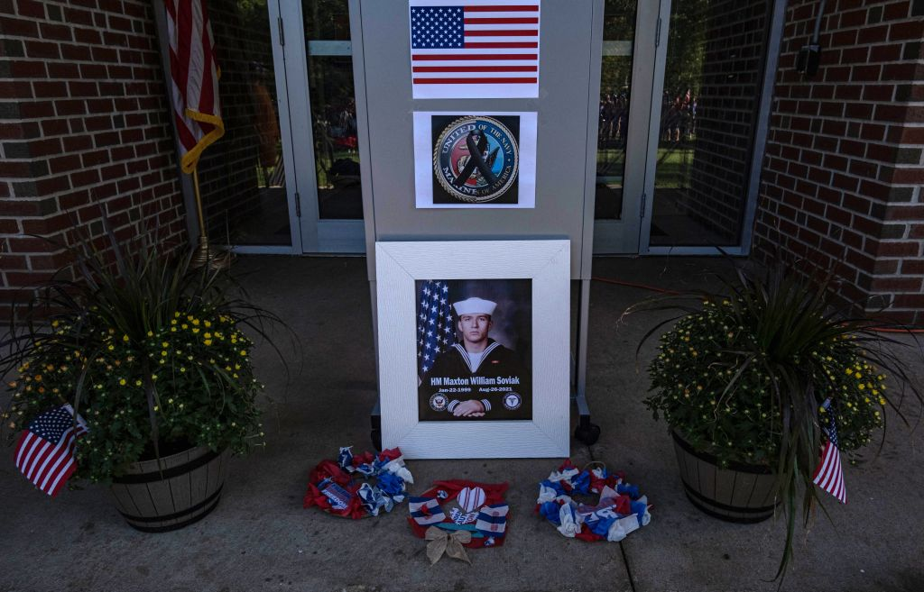 """A memorial is seen outside of Edison Middle School for Navy Corpsman Maxton """"Max"""" W. Soviak in Berlin Heights, Ohio ahead of a vigil for the fallen Navy Corpsman on August 29, 2021. - Soviak was killed during the August 26 terror attack outside of Kabul Airport in Afghanistan along with 12 other American service members and more than 100 Afghans. (Photo by SETH HERALD / AFP) (Photo by SETH HERALD/AFP via Getty Images)"""