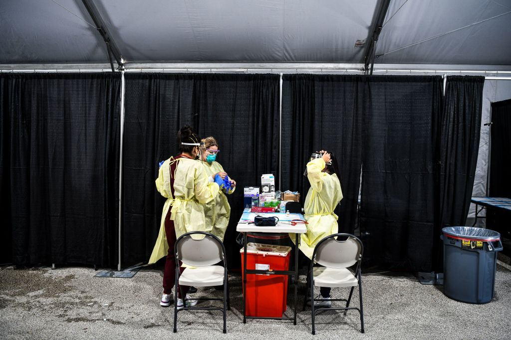 Health care workers work inside the Regeneron Clinic at a monoclonal antibody treatment site in Pembroke Pines, Florida, on August 19, 2021. - Florida Governor Ron DeSantis announced the opening of the Covid-19 antibody treatment site. DeSantis continues to promote the monoclonal antibody treatments as cases and hospitalizations spike in Florida. Starting Wednesday, C.B. Smith Park will start offering the antibody treatment from 9 a.m. to 5 p.m. seven days a week. The site will be able to treat over 300 patients a day. (Photo by CHANDAN KHANNA / AFP) (Photo by CHANDAN KHANNA/AFP via Getty Images)