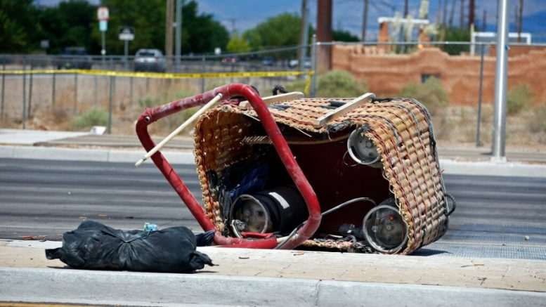 The basket of a hot air balloon which crashed lies on the pavement in Albuquerque, N.M., Saturday, June 26, 2021. Police said the five occupants died after it crashed on the busy street. (AP Photo/Andres Leighton)