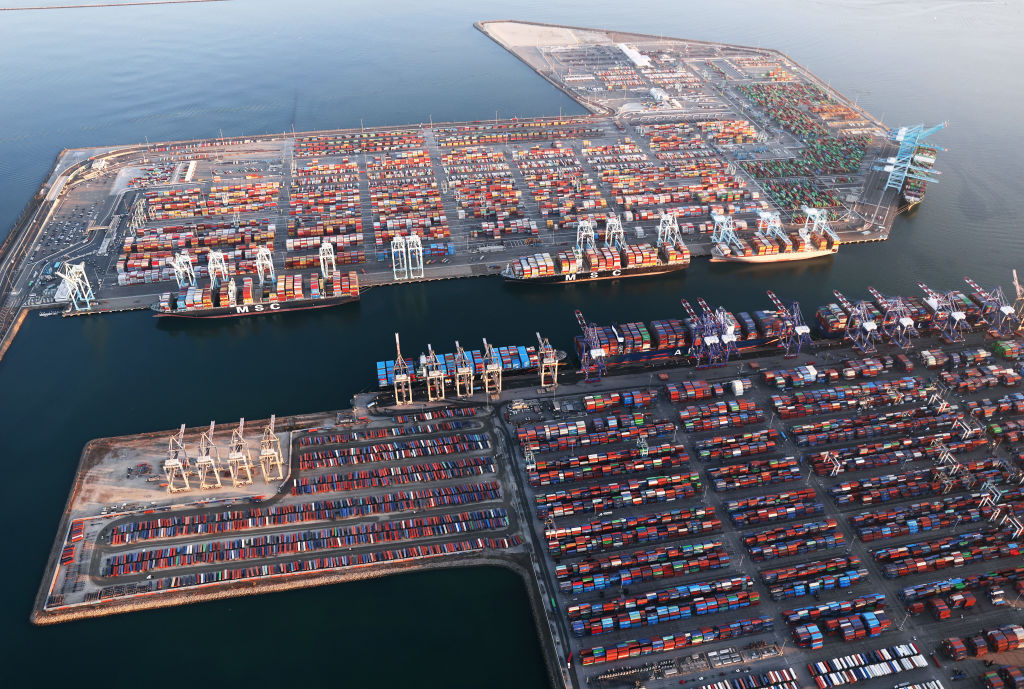 LOS ANGELES, CALIFORNIA - SEPTEMBER 20: In an aerial view, shipping containers and container ships are seen at the Port of Los Angeles on September 20, 2021 near Los Angeles, California. Amid nationwide record-high demand for imported goods and supply chain issues, the twin ports of Los Angeles and Long Beach are currently seeing unprecedented congestion. On September 17, there were a record total of 147 ships, 95 of which were container ships, in the twin ports, which move about 40 percent of all cargo containers entering the U.S. (Photo by Mario Tama/Getty Images)