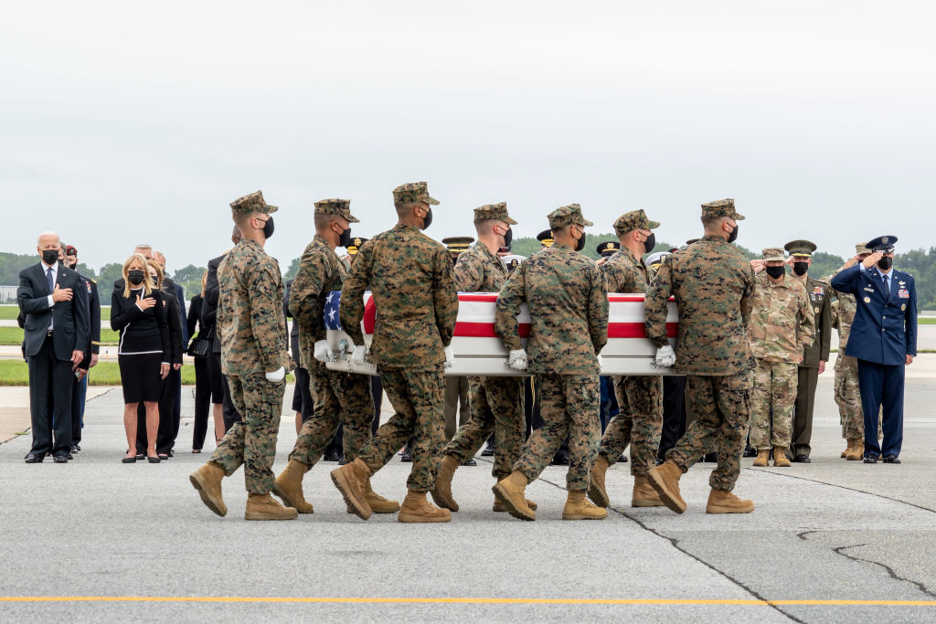 DOVER, DELAWARE - AUGUST 29: In this handout photo provided by the U.S. Air Force, a U.S. Marine Corps carry team transfers the remains of Marine Corps Cpl. Daegan W. Page of Omaha, Nebraska, Aug. 29, 2021 at Dover Air Force Base, Delaware. Page was assigned to 2nd Battalion, 1st Marine Regiment, 1st Marine Division, I Marine Expeditionary Force, Camp Pendleton, California. (Photo by Jason Minto/U.S. Air Force via Getty Images)
