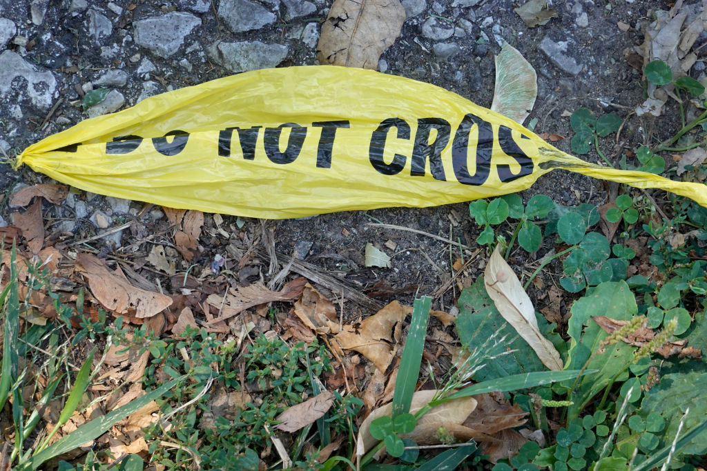 CHICAGO, ILLINOIS - AUGUST 16: Remnants of police crime scene tape remain near the site where two young girls were shot after leaving their grandmother's home yesterday on August 16, 2021 in Chicago, Illinois. The two girls were shot as their mother was buckling them in her vehicle. Seven-year-old Serenity Broughton died from her injuries. Broughton's 6-year-old sister Aubrey was seriously wounded and remains in the hospital following the shooting, which occurred on August 15. (Photo by Scott Olson/Getty Images)