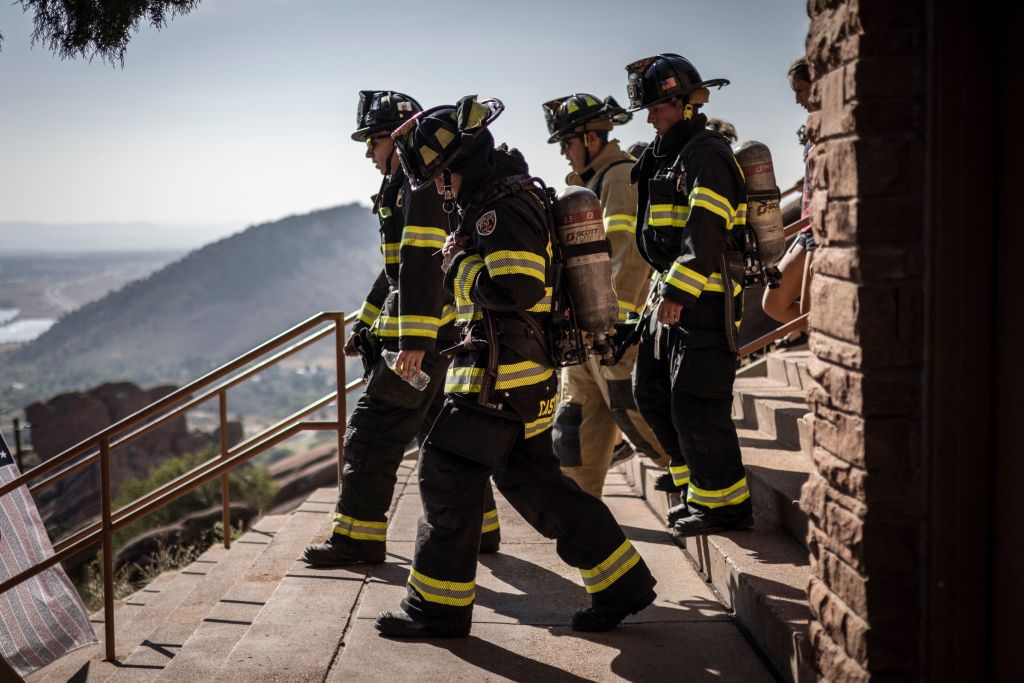 Firefighters in full gear, first responders, victims family members and supporters participate in the 2021 Colorado 9/11 Memorial Stair Climb at the Red Rocks Park and Amphitheatre on September 11, 2021 in Morrison, outside Denver, Colorado. - Participants walk nine laps around the Red Rocks Amphitheater, which is equivalent to the 110 floors of the World Trade Center. (Photo by Chet Strange / AFP) (Photo by CHET STRANGE/AFP via Getty Images)