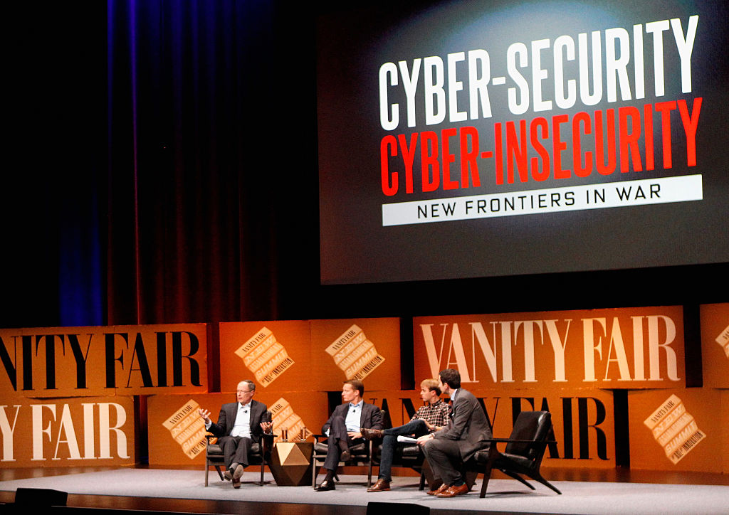 """SAN FRANCISCO, CA - OCTOBER 08: (L-R) General (Ret.) Keith Alexander, FireEye COO Kevin Mandia, Lookout Founder and Executive Chairman John Hering and The New York Times Columnist and Moderator Andrew Ross Sorkin speak onstage during """"Cyber-Security/Cyber-Insecurity"""" at the Vanity Fair New Establishment Summit at Yerba Buena Center for the Arts on October 8, 2014 in San Francisco, California. (Photo by Kimberly White/Getty Images for Vanity Fair)"""