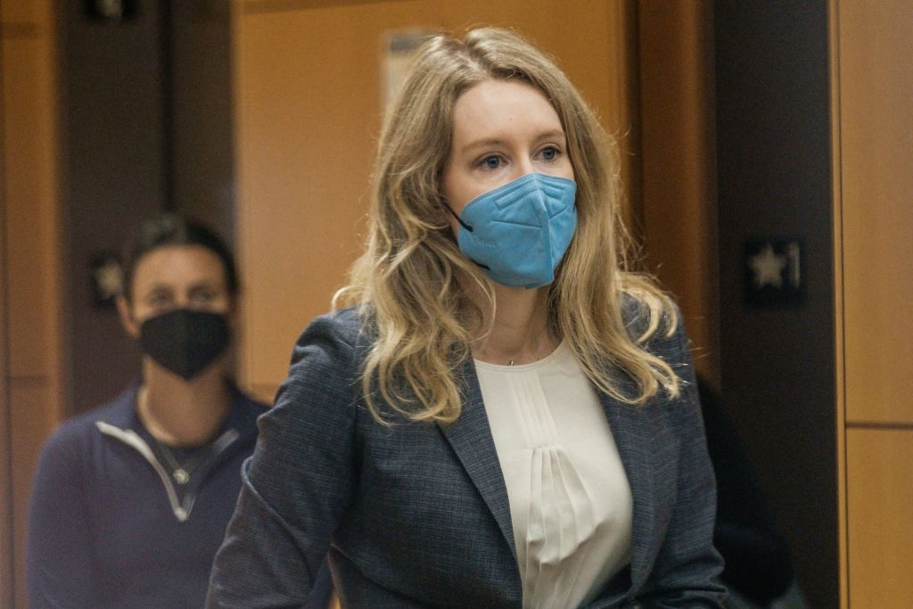 Elizabeth Holmes, the founder and former CEO of blood testing and life sciences company Theranos, arrives for the first day of her fraud trial, outside Federal Court in San Jose, California. September 8, 2021. - California jurors tasked with deciding whether fallen biotech star Elizabeth Holmes is guilty of a stunning fraud or is herself a victim were set to hear opening arguments in her trial on September 8, 2021. Federal prosecutors in the heart of Silicon Valley have in their filings portrayed Holmes as a villain who swindled investors in the diagnostics company Theranos -- which she founded at age 19 -- with tests that did not work. (Photo by Nick Otto / AFP) (Photo by NICK OTTO/AFP via Getty Images)