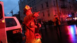 A Firefighter attends a emergency on the scene where active shooting is happening in Jersey City on December 10, 2019. - A shooting in a New York suburb not far from the Statue of Liberty left a police officer dead on Tuesday, and reports said several other people may have been killed during two hours of gunfire. The local prosecutor said that one officer was killed and three other people -- two of them police -- had been wounded in Jersey City, New Jersey, across the Hudson River from New York. Media reports said the Jersey City shooting began when an officer, investigating a homicide, approached the store, which is near a synagogue and a school. Hundreds of rounds were fired in the ensuing shootout. (Photo by Kena Betancur / AFP) (Photo by KENA BETANCUR/Afp/AFP via Getty Images)