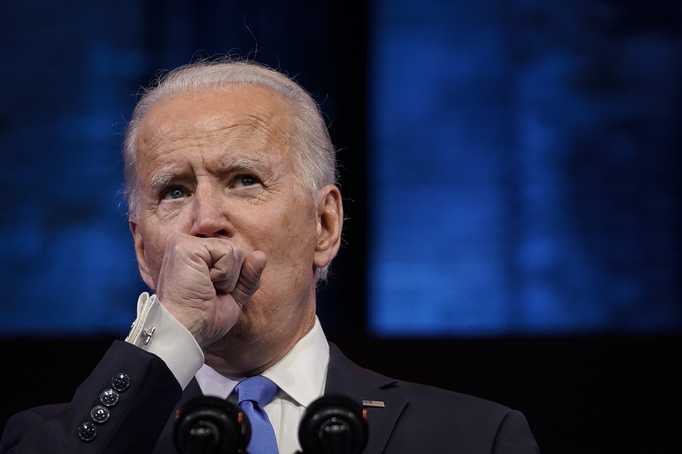 Joe Biden stopped multiple times during a Monday speech to clear his throat, prompting a response from some social media users. DREW ANGERER/GETTY