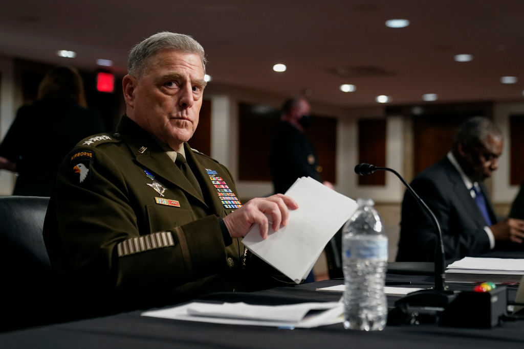 WASHINGTON, DC - SEPTEMBER 28: Chairman of the Joint Chiefs of Staff Gen. Mark A. Milley gathers his items after speaking at a Senate Armed Services Committee hearing on the conclusion of military operations in Afghanistan and plans for future counterterrorism operations on Capitol Hill on September 28, 2021 in Washington, DC. (Photo by Patrick Semansky-Pool/Getty Images)