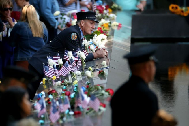 NEW YORK, NEW YORK - SEPTEMBER 11: Family, friends and colleagues of those killed in the 9/11 and the 1993 bombing terror attacks participate in the annual commemoration ceremony at the National 9/11 Memorial and Museum on September 11, 2021 in New York City. The nation is marking the 20th anniversary of the terror attacks of September 11, 2001, when the terrorist group al-Qaeda flew hijacked airplanes into the World Trade Center, Shanksville, PA and the Pentagon, killing nearly 3,000 people. (Photo by Chip Somodevilla/Getty Images)
