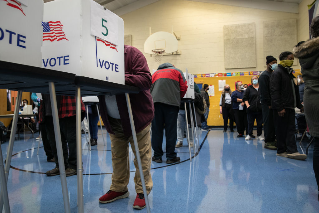 LANSING, MICHIGAN - NOVEMBER 03: Voters fill out their ballots at a school gymnasium on November 03, 2020 in Lansing, Michigan. After a record-breaking early voting turnout, Americans went to the polls on the last day to cast their vote for incumbent U.S. President Donald Trump or Democratic nominee Joe Biden in the 2020 presidential election. (Photo by John Moore/Getty Images)