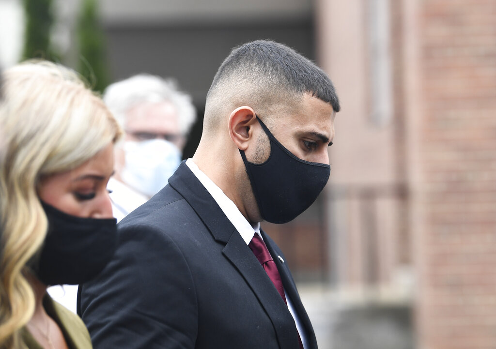 Nauman Hussain, center, leaves court Thursday, Sept. 2, 2021, in Schoharie, N.Y. Hussain, the operator of a limousine company was spared prison time Thursday in a 2018 crash that killed 20 people when catastrophic brake failure sent a stretch limo full of birthday revelers hurtling down a hill in upstate New York.(AP Photo/Hans Pennink)