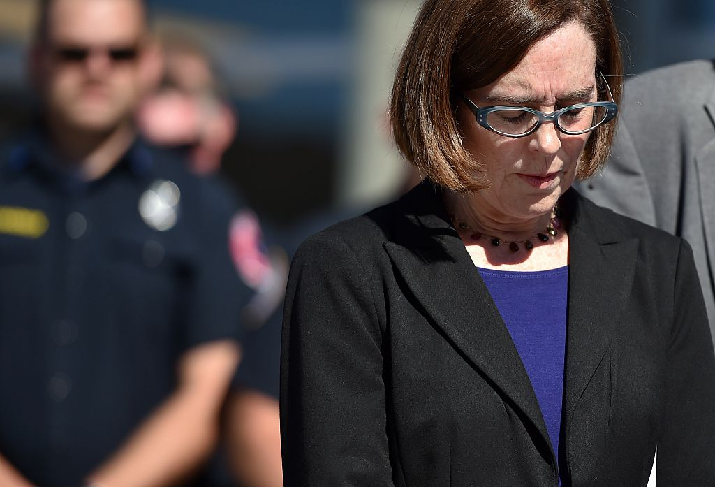 Oregon Governor Kate Brown reacts during a press conference in Roseburg, Oregon on October 2, 2015. As police and mourners groped for answers in the latest carnage to hit gun-crazed America, a portrait started to emerge Friday of the Oregon community college shooter: an angry recluse who hated religion. The rampage Thursday by a heavily armed young man identified as Chris Harper Mercer, 26, left 10 dead and shattered a close-knit rural community in the south of the state. AFP PHOTO/JOSH EDELSON (Photo credit should read Josh Edelson/AFP via Getty Images)