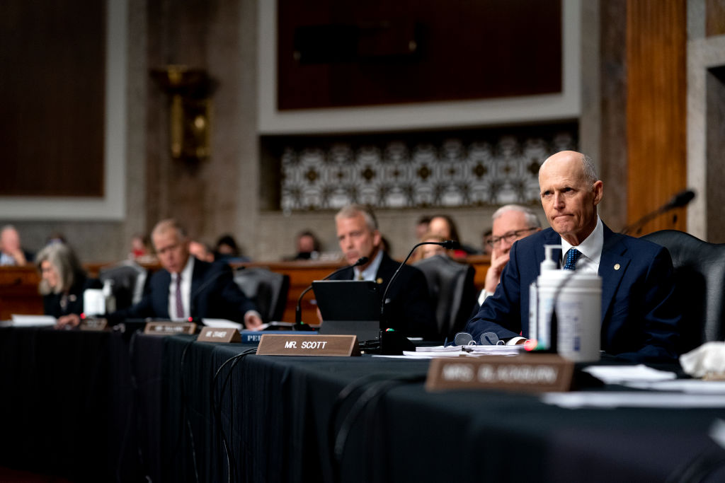 WASHINGTON, DC - SEPTEMBER 28: Sen. Rick Scott (R-FL) listens during a Senate Armed Services Committee hearing on the conclusion of military operations in Afghanistan and plans for future counterterrorism operations at the Dirksen Senate Office building on Capitol Hill on September 28, 2021 in Washington, DC. (Photo by Stefani Reynolds-Pool/Getty Images)