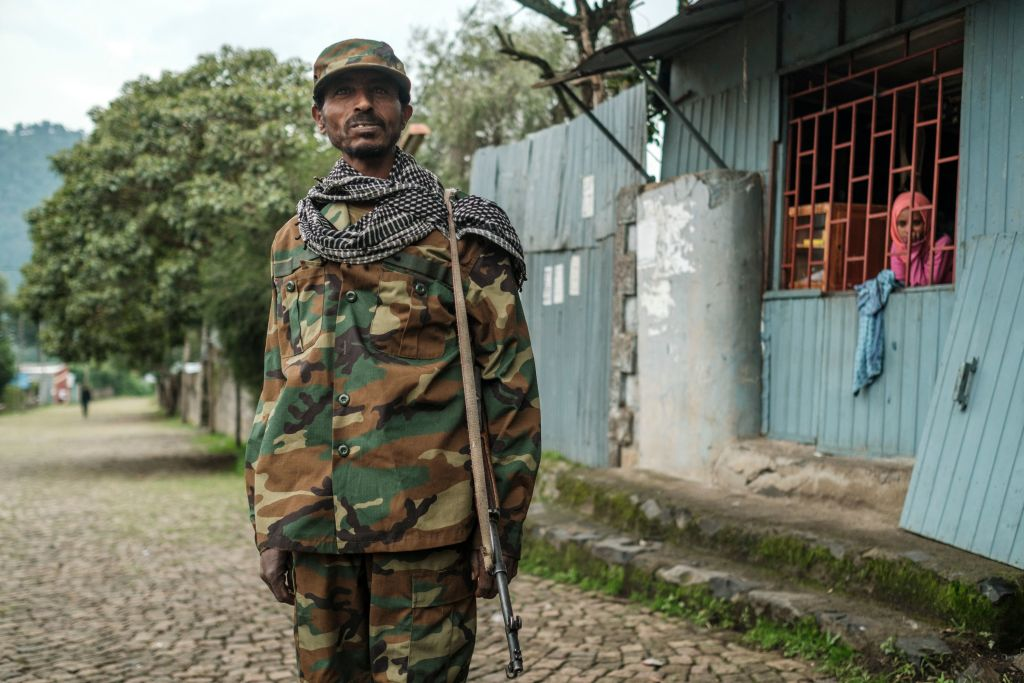 A member of the Amhara militia stands with his gun during a graduation ceremony of Recruits for reserves of Amhara regional forces, in the city of Dessie, Ethiopia, on August 24, 2021. - Long confined to Tigray, the conflict in Ethiopia has recently spread to two neighbouring regions, Afar and Amhara, with heavy weapons fire killing an untold number of civilians and displacing hundreds of thousands more. (Photo by EDUARDO SOTERAS / AFP) (Photo by EDUARDO SOTERAS/AFP via Getty Images)