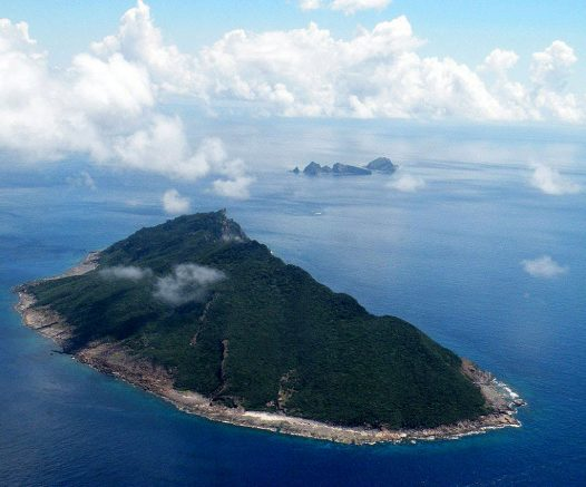 """This aerial shot taken on September 15, 2010 shows the disputed islands known as Senkaku in Japan and Diaoyu in China in the East China Sea. China pledged on September 5, 2012 to take """"necessary measures"""" to defend its territory after Japanese media said Tokyo had agreed to buy a contested group of islands. AFP PHOTO / JIJI PRESS JAPAN OUT (Photo credit should read JIJI PRESS/AFP/GettyImages)"""