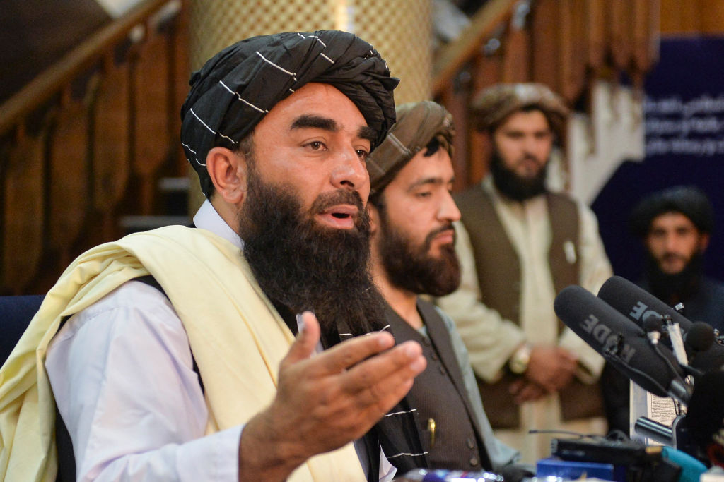 Taliban spokesperson Zabihullah Mujahid (L) gestures as he speaks during the first press conference in Kabul on August 17, 2021 following the Taliban stunning takeover of Afghanistan. (Photo by Hoshang Hashimi / AFP) (Photo by HOSHANG HASHIMI/AFP via Getty Images)