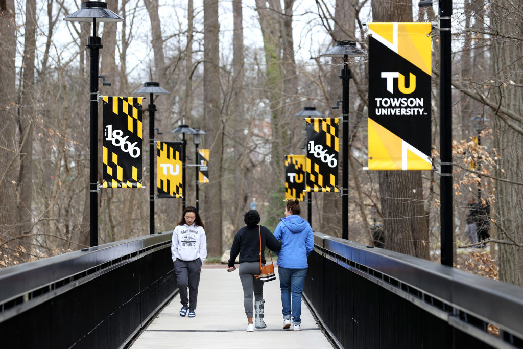 TOWSON, MARYLAND - MARCH 11: Towson University students walk on campus as the school shut down days before the start of the scheduled spring break on March 11, 2020 in Towson, Maryland. Universities across the nation have closed through spring break as the novel Coronavirus spreads. (Photo by Rob Carr/Getty Images)