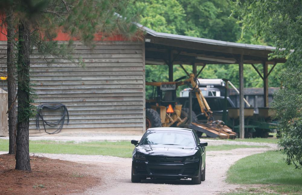 FILE - In this June 8, 2021, file photo, a vehicle sits in the driveway of a home in rural Colleton County, near Islandton, S.C., where a mother and son from a prominent South Carolina legal family were found shot and killed. The Post and Courier newspaper in Charleston is suing state agents, saying they are withholding information about the killings that should be public under the state's Freedom of Information Act. (Andrew J. Whitaker/The Post And Courier via AP, File)