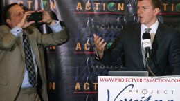 """WASHINGTON, DC - SEPTEMBER 01: Conservative undercover journalist James O'Keefe (L) is photographed by Project Veritas Action Senior Communications Strategist Stephen Gordon during a news conference at the National Press Club September 1, 2015 in Washington, DC. O'Keefe released a video of that accuses the Democratic frontrunner Hillary Clinton's director of marketing and FEC compliance director of breaking the law by allowing a Canadian tourist to buy $75 of campaign swag using the Project Veritas Action journalist as a straw purchaser. O'Keefe promised that people will resign from their jobs as his """"Army of Exposers"""" record and release more undercover videos during the 2016 campaign. (Photo by Chip Somodevilla/Getty Images)"""