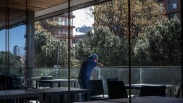 STANBUL, TURKEY - APRIL 17: A nurse working in the COVID-19 dedicated ICU (Intensive Care Unit) takes a break outside at the Acibadem Altunizade Hospital on April 17, 2020 in Istanbul, Turkey. Since the start of the Corona virus outbreak in Turkey on March 11, 2020, Acibadem Altunizade Hospital has dealt with many of the most severe cases, due to being one of Turkey's most high-tech facilities. At the start of the outbreak the hospital formed a 175 strong specialized corona team, taking doctors, nurses and assistant staff from all departments of the hospital and transforming three areas of the hospital into specialty facilities dedicated to COVID-19 cases, including an emergency entrance, a 23-bed dedicated ICU and an in-patient ward for non-severe or recovering patients. As of April 19, according to the Health Ministry, Turkey has 2,017 Coronavirus related deaths and confirmed cases have risen to 86,306 overtaking neighboring Iran. Despite the rising numbers Turkey has avoided a full lockdown and continues to implement 48-hr weekend lockdowns and constant revisions of current restrictions. The interior ministry has extended restrictions on travel between 31 cities for another 15 days, a curfew continues to be in place for anyone over the age of 65 and under 20, schools, cafes, bars and non-essential businesses remain closed. (Photo by Chris McGrath/Getty Images)