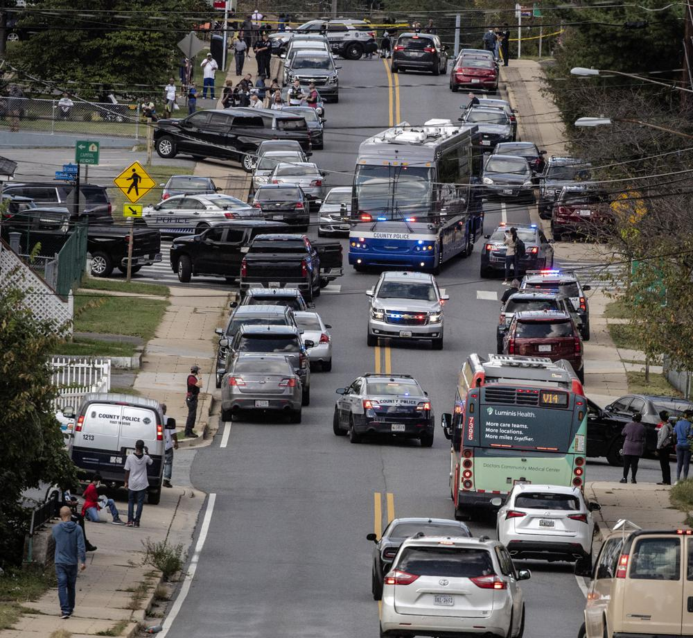 Police respond to the scene of a shooting at a senior housing apartment on Friday, Oct. 8, 2021 in Capitol Heights, Md. Two people were fatally shot Friday at the Maryland senior living facility just outside of Washington, D.C., and one suspect is in custody, police said. (Bill O'Leary/The Washington Post via AP)