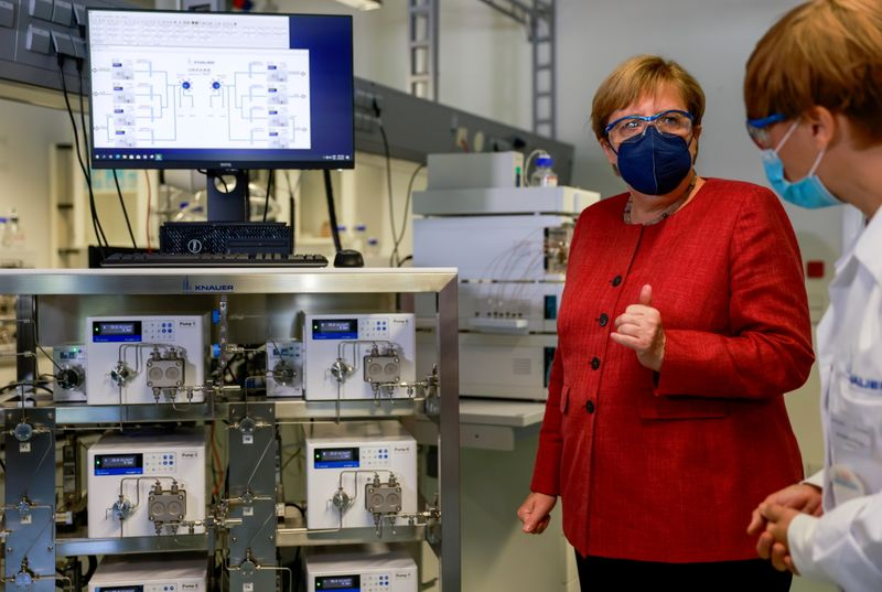 FILE PHOTO: German Chancellor Angela Merkel visits laboratory measuring device producer Knauer in Berlin, Germany
