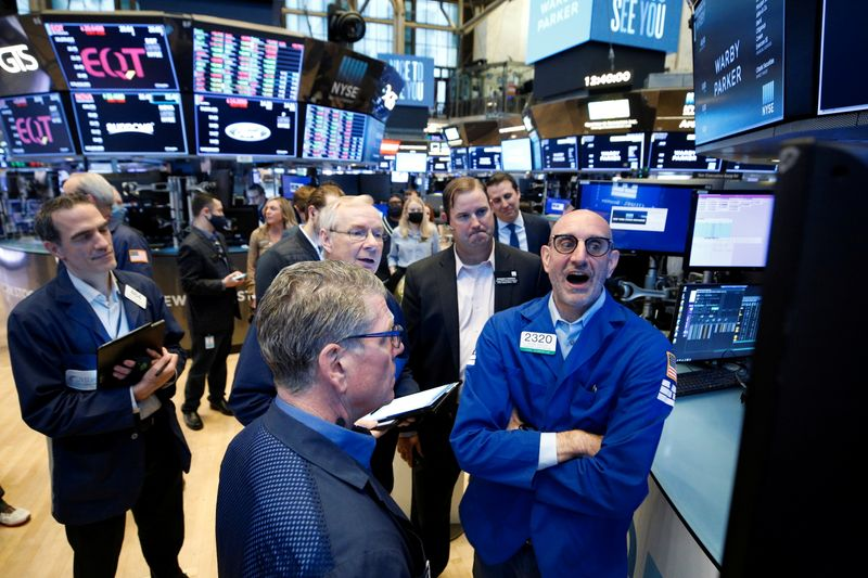 Traders gather during the direct listing of eyeglass retailer Warby Parker at the NYSE in New York