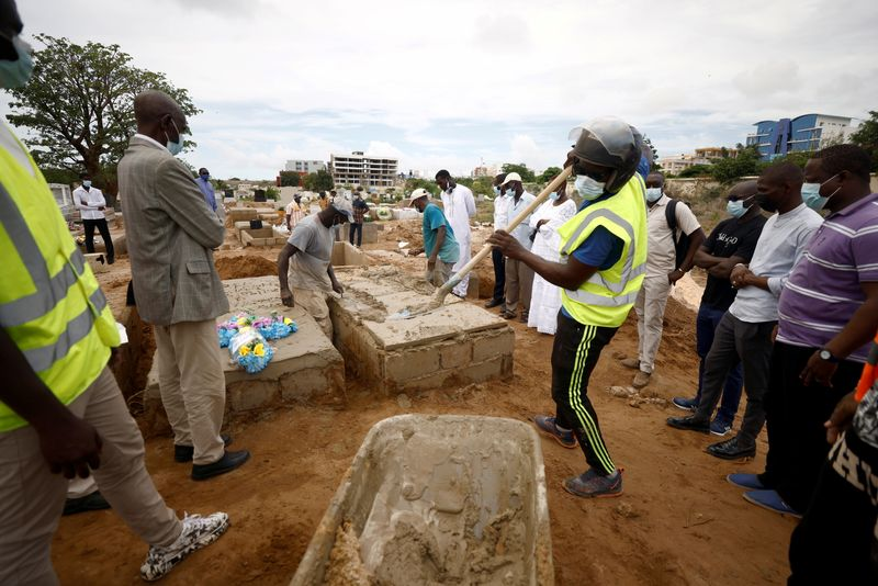 FILE PHOTO: Pace of burials rises as Senegal records more COVID-19 deaths