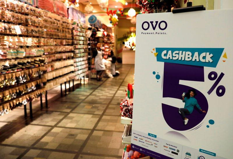 FILE PHOTO: A sign of OVO payment is seen at a mall in Jakarta