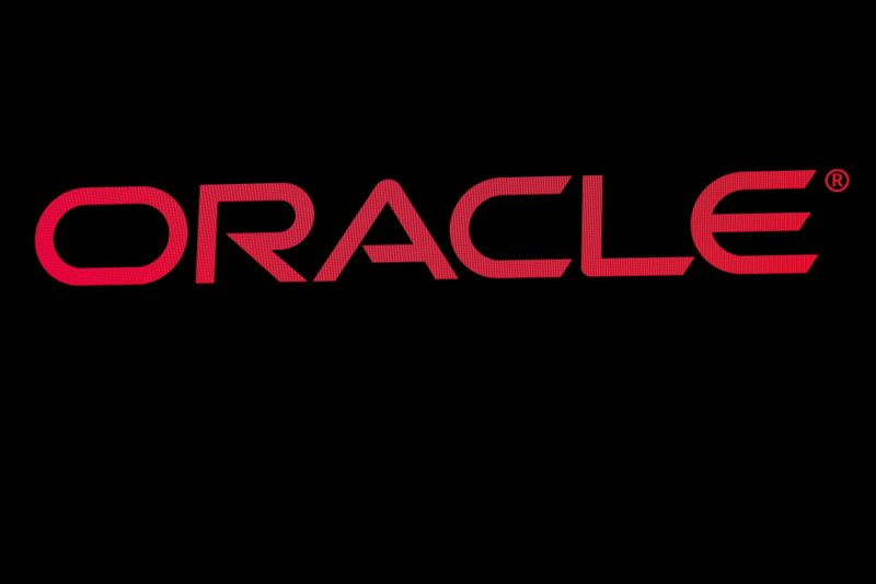FILE PHOTO: The company logo for Oracle Corp. is displayed on a screen on the floor at the NYSE in New York
