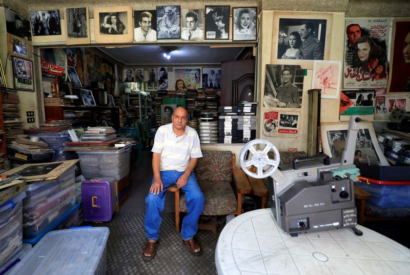 Makram Salama, poses for a photograph at his apartment's museum full of Egypt's cinematic gems in Alexandria