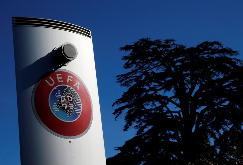 FILE PHOTO: A logo is pictured outside the UEFA in Nyon