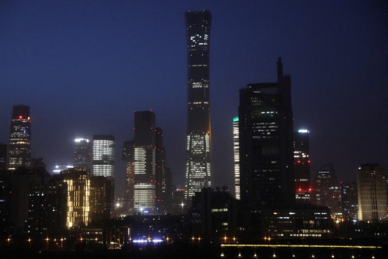 FILE PHOTO: Buildings in the Central Business District (CBD) are seen lit up during the night in Beijing