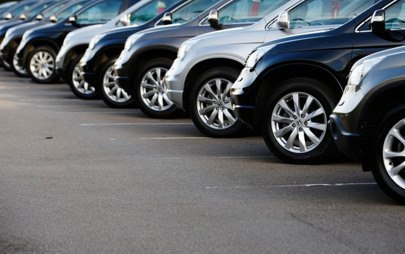 FILE PHOTO: Cars are displayed outside a showroom in west London