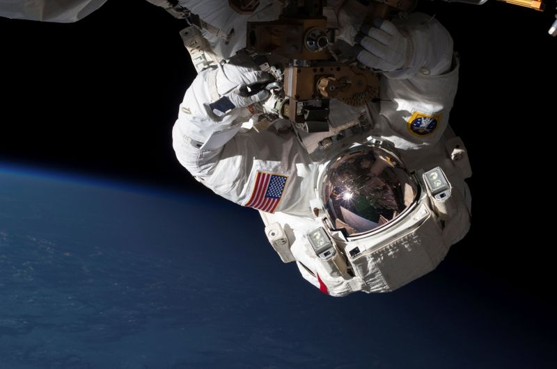 FILE PHOTO: NASA handout shows NASA Expedition 35 Flight Engineers Cassidy and Marshburn conducting a spacewalk to inspect and replace a pump controller box on the International Space Station's far port truss