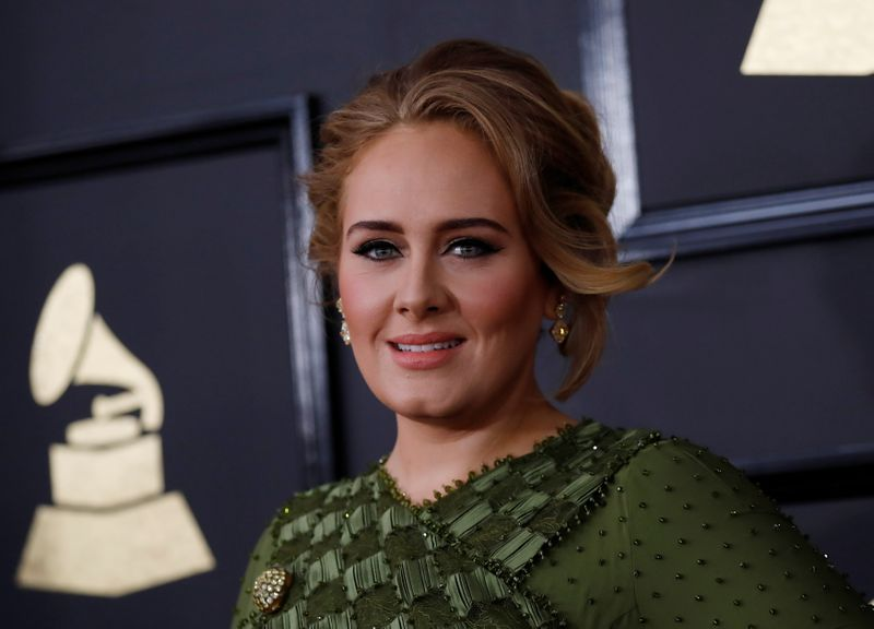 FILE PHOTO: Singer Adele arrives at the 59th Annual Grammy Awards in Los Angeles