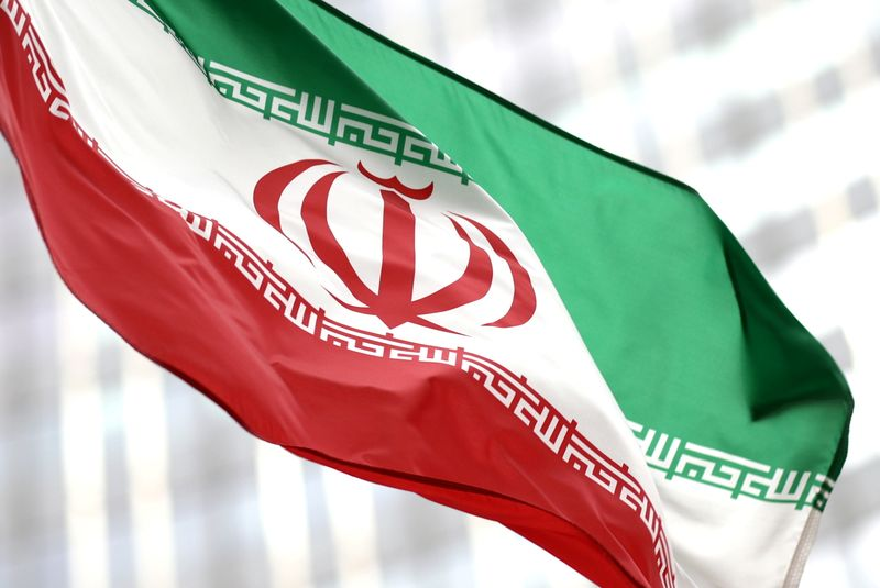 FILE PHOTO: Iranian flag flies in front of the UN office building in Vienna