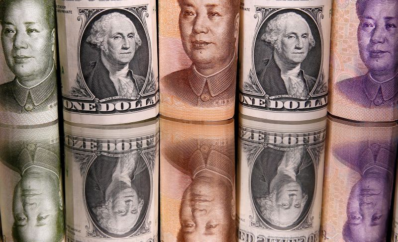 FILE PHOTO: Chinese Yuan and U.S. dollar banknotes are seen in this illustration