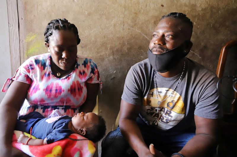 Macdalla Renois holds her daughter Angelina as she and her husband Oberto Destinoble talk to Reuters after they were deported from Del Rio, Texas, by U.S. authorities, in Port-au-Prince