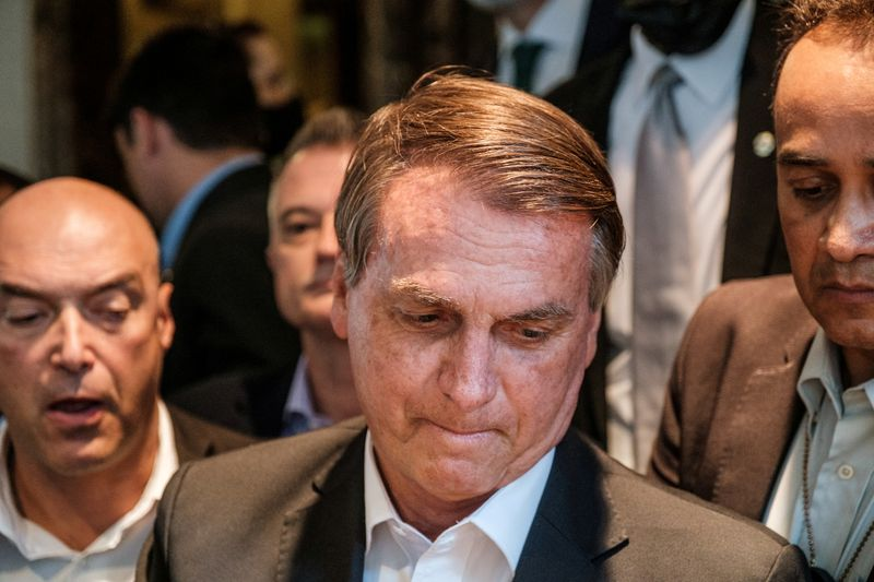 FILE PHOTO: Brazil's President Jair Bolsonaro greets supporters outside his hotel during the 76th Session of the U.N. General Assembly in New York