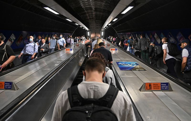 Workers travel through London Bridge rail and underground station during the morning rush hour in London