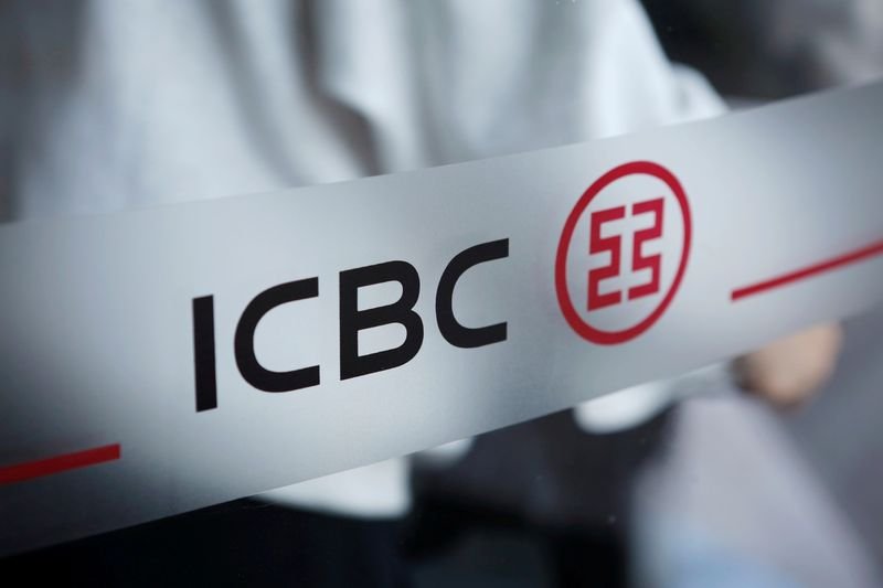 FILE PHOTO: FILE PHOTO: The logo of Industrial and Commercial Bank of China (ICBC) is pictured at the entrance to its branch in Beijing