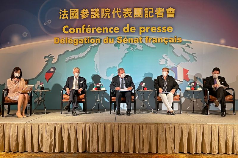 Alain Richard and other members of the French delegation attend a news conference in Taipei