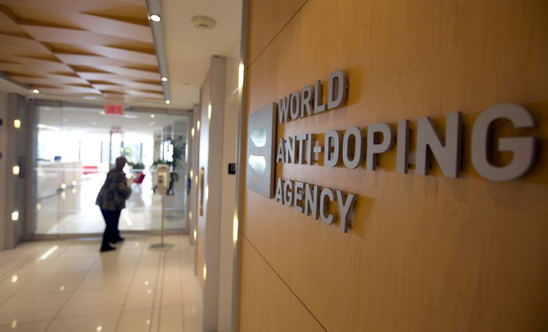 FILE PHOTO: A woman walks into the head offices of WADA in Montreal