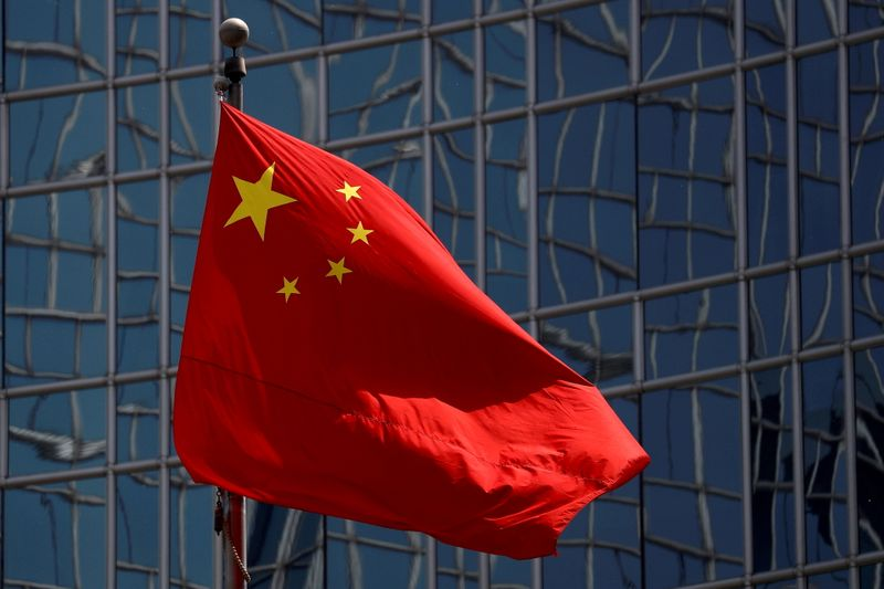 FILE PHOTO: The Chinese national flag is seen in Beijing, China