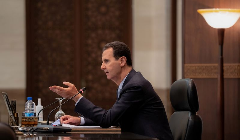 FILE PHOTO: Syrian President Bashar al-Assad meets with the Syrian cabinet in Damascus