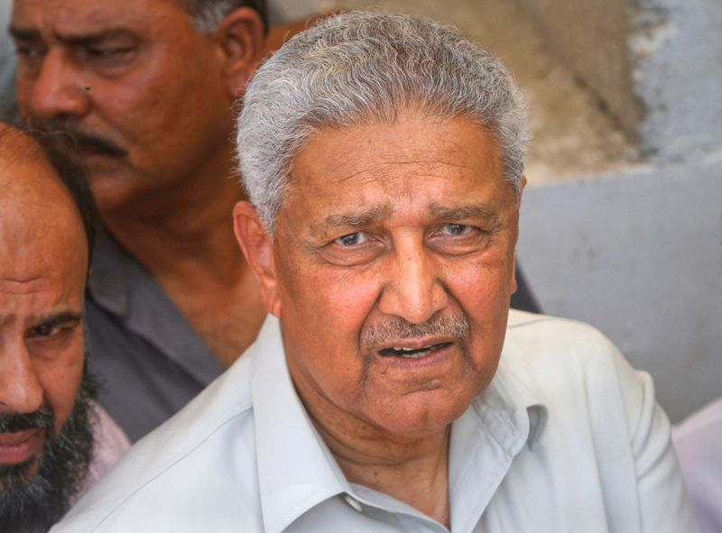 FILE PHOTO: Pakistani nuclear scientist photograph after a media silent prayer over the grave of his brother during his funeral services in Karachi